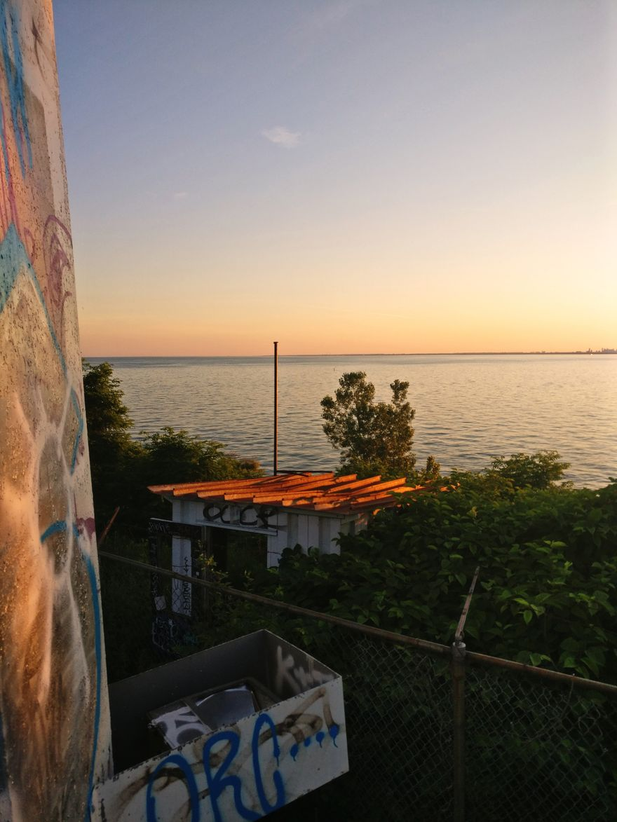sunset shot of the lake by Tommy Thompson Park also known as the Leslie Street Spit