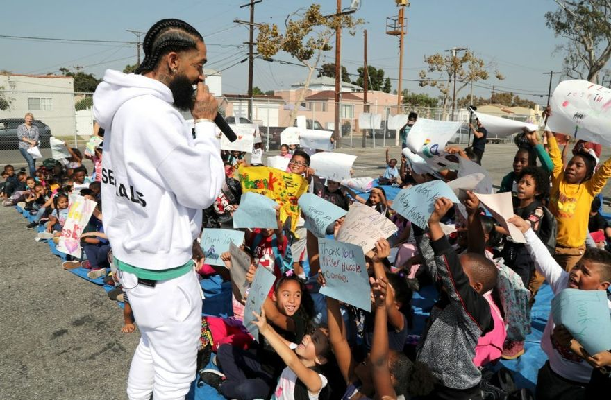 Nipsey Hussle performing live for a crowd of kids