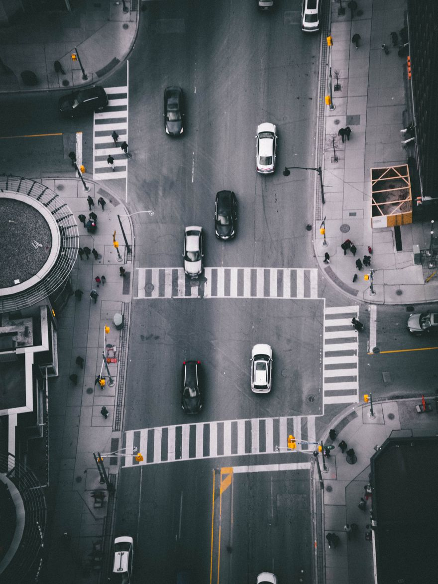 sky view of cars and people moving through busy intersection in Toronto